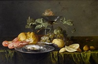a still life of prawns, a bread roll, an oyster on a pewter dish, a glass of beer, a wine glass, grapes, lemons and walnuts on a table... by alexander coosemans