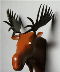 moose head mounted in black, brown and white colors by adelard cote