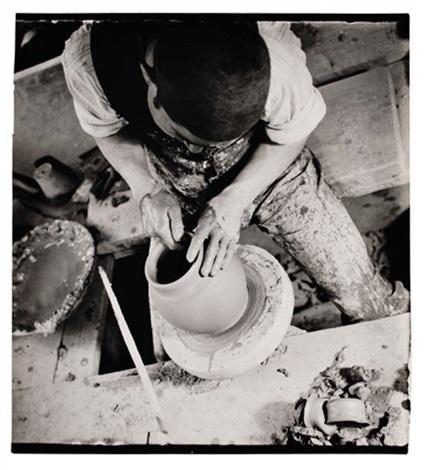untitled man throwing a vase by jaromir funke