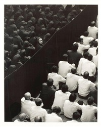 fervor series (crowd from back woman looking over her shoulder) by shirin neshat