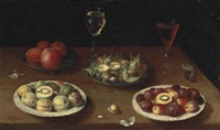 hazelnuts and walnuts, and apples on pewter platters, plums and nectarines on porcelain plates, with glasses of red and white wine, and a butterfly by osias beert the elder