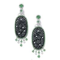 a pair of ear pendants by michael youssoufian