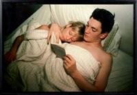 patrick & terri reading baudelaire, new york by nan goldin