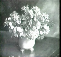 still life of mixed flowers in a bowl by charles a. buchel