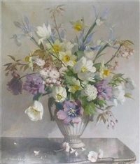still life of spring flowers in an urn shaped vase by vernon ward