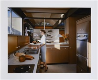 ruth bass in the kitchen of the bass house in their case study house n°8, pacific palisades by julius shulman