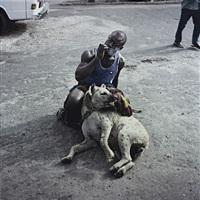 abdullahi mohammed with mainasara, lagos, nigeria 2007 (from gadawan kura - the hyena men, series ii) by pieter hugo