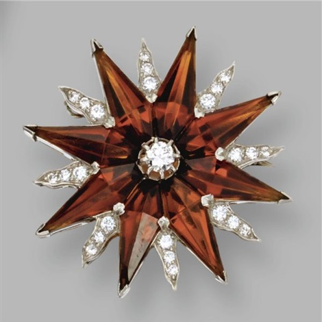 a brooch designed as a starburst by bailey banks and biddle