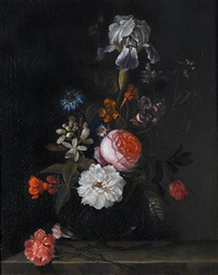 roses, an iris, carnations and other flowers in a glass vase on a stone ledge by cornelis kick