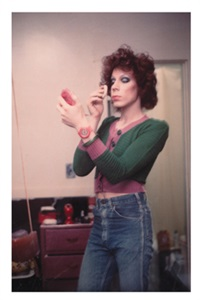 kenny putting on make-up, boston, 1973 by nan goldin