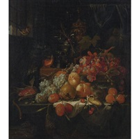 still life with grapes, fruit, corn and a bird by abraham mignon