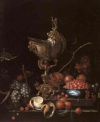 still life of various fruits on a ledge with a gold mounted nautilus shell by cornelis de bryer