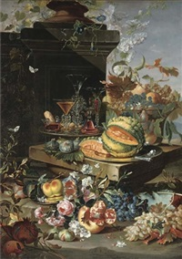 a sliced pumpkin on a silver plate, façon-de-venise glasses on a second silver plate, grapes, peaches and plums in a glass bowl with more grapes, figs, a pomegranate, roses and a peach on a silve by christian berentz