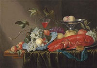 grapes, peaches, cherries and figs in a wan-li porcelain bowl, a lobster, with an orange and lemon, on a pewter platter... by cornelisz mahu