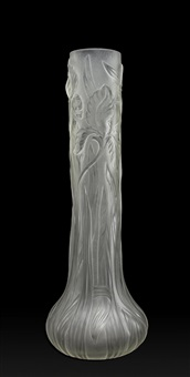 very tall clear and frosted glass vase of cylinder form with bulbous base decorated in relief with flowering irise by louis comfort tiffany