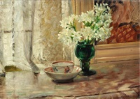 still life with a porcelain cup and saucer and a vase with flowers by willem elisa roelofs