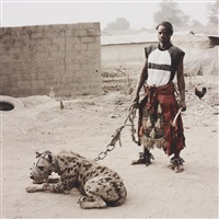 mallam mantari lamal with mainasara, abuja, nigeria from gadawan kura - the hyena men by pieter hugo