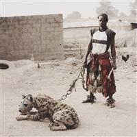 mallam mantari lamal with mainasara, abuja, nigeria from gadawan kura - the hyena men by pieter hugo