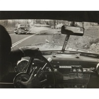 car passing, car viewed from steering wheel by arnold eagle