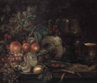 a roemer, an overturned tazza, and fruit on a pewter plate on a table by gerrit willemsz heda