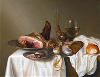 still life with a ham, a glass and a nautilus cup on a table draped with a white cloth by maerten boelema de stomme