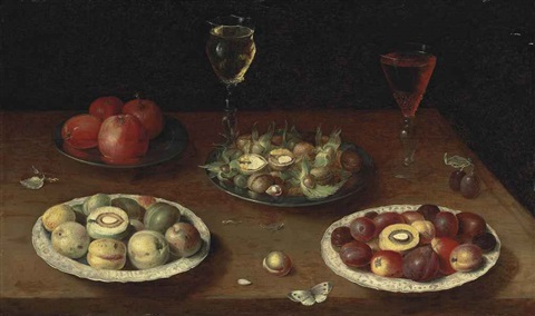 hazelnuts and walnuts and apples on pewter platters plums and nectarines on porcelain plates with glasses of red and white wine and a butterfly on a wooden table by osias beert the elder