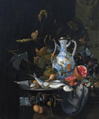 a still life with a chinese porcelain jug, a pewter plate with a herring, a pomegranate, a knife, an onion, grapes and cherries, together with a snail and a butterfly, all on a stone table draped with a grey cloth by jan mortel