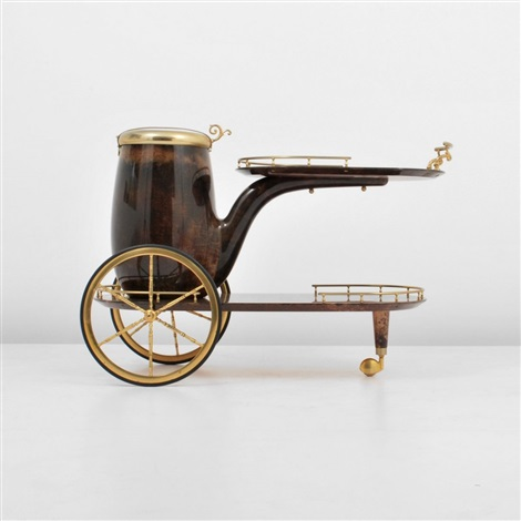 ice bucket in the form of a pipe and on wheels by aldo tura