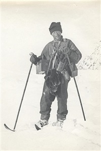 levick laden with camera and instrument cases, with skis and wearing finnesko by george murray levick