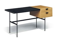 a desk by pierre paulin