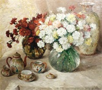 a still life of carnations and a tea set by aristide goffinon