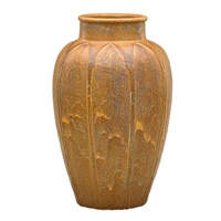 large vase carved with leaves by grueby
