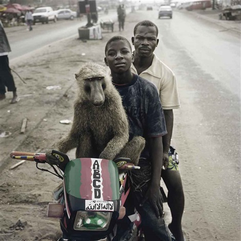 emeka motorcyclist and abdullah ahmadu asaba nigeria by pieter hugo