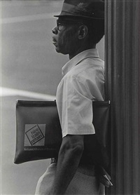 untitled (man with portfolio) by roy decarava