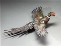flying ring-necked pheasant by mike capser