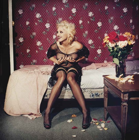 madonna laughing and holding her breasts by bettina rheims
