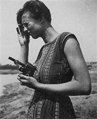 woman with camera (katt both?) by hilda hubboch