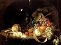 still life in a niche with fruit, nuts, oyster, wine goblet and fluted glass by abraham mignon