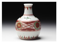 a sake bottle with red circle patterns by kitaoji rosanjin