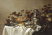 a silver plate with two roemers, a sliced ham and fish, a wan-li porcelain bowl, bread, a tin jug and wicker basket with grapes and vines... by roelof koets the elder