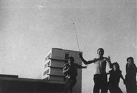 bauhaus students with bauhaus building in the background by t. lux feininger