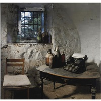 basement with typewriter and bottles by yuval yairi