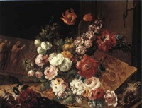 still life with flowers with stone bas-reliefs on a table by benito espinos