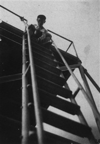 alfred arndt at top of a ladder by gertrud arndt