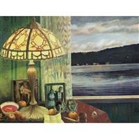 mesa con objetos y vista al lago al atardecer by elena climent