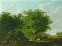 a wooded landscape with a cowherd and cattle by a cottage by adrianus van der koogh