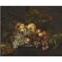 a still life with grapes, peaches and other fruit in a porcelain dish on a partially-draped table by bartholomeus assteyn
