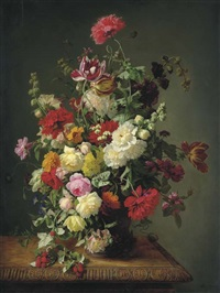 a still life of roses, tulips, peonies, carnations, hollyhocks, morning glories, dahlias and raspberries in an urn on a carved wooden table by simon saint-jean