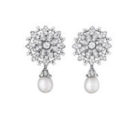 a pair of diamond and cultured pearl ear pendants by chaumet