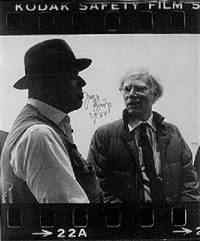 two photogaphs of a conversation by joseph beuys and andy warhol